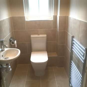 Modern cloakroom with heated towel rail