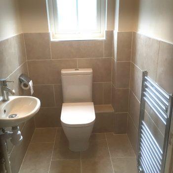 Modern cloakroom with heated towel rail