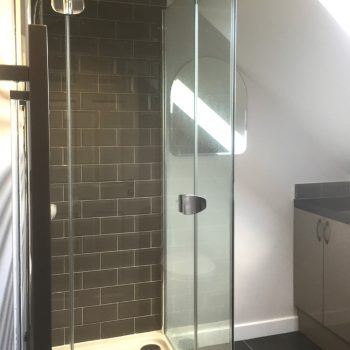Shower enclosure grey metro tiles