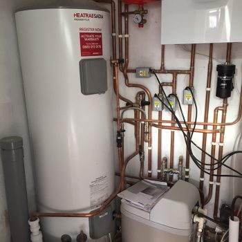 New boiler, water tank and water softener installed in extension in Ely.